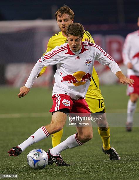 Alejandro Moreno of the Columbus Crew and Luke Sassano of the New York Red Bulls battle for the ball at Giants Stadium in the Meadowlands on April 5...