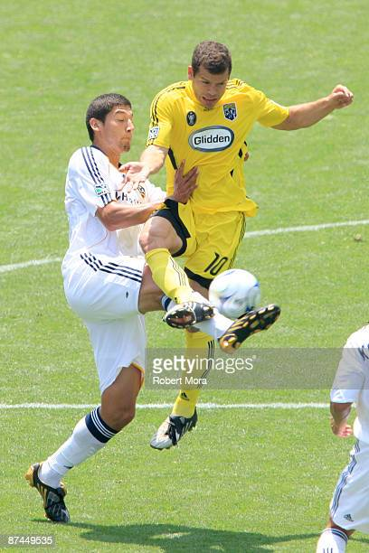 Alejandro Moreno of the Columbus Crew attempts to control a loose ball past Omar Gonzalez of the Los Angeles Galaxy during their MLS game at The Home...