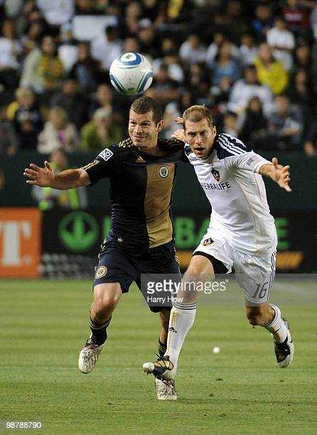 Alejandro Moreno of the Philadelphia Union and Greg Berhalter of the Los Angeles Galaxy chase a ball during the first half at the Home Depot Center...