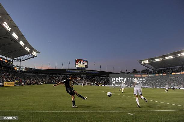 Alejandro Moreno of the Philadelphia Union centers the ball past Gregg Berhalter of the Los Angeles Galaxy during the first half at the Home Depot...