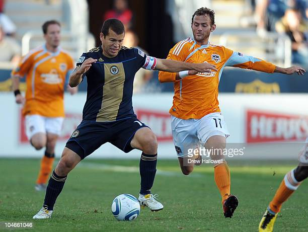 Alejandro Moreno of the Philadelphia Union keeps the ball away from Brad Davis of the Houston Dynamo at PPL Park on October 2 2010 in Chester...