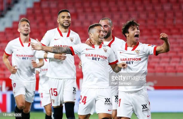 Alejandro Papu Gomez of Sevilla FC celebrates scoring a goal with team mates during the La Liga Santander match between Sevilla FC and Deportivo...