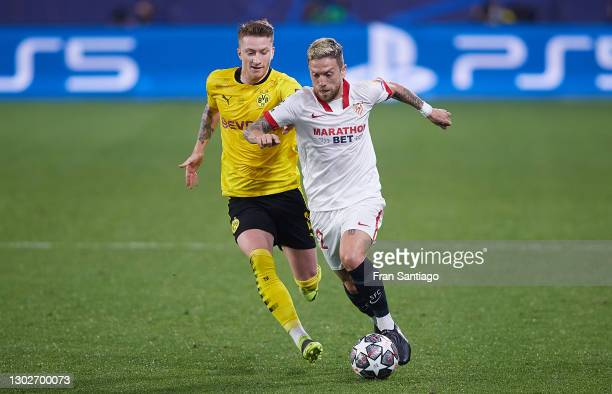Alejandro Papu Gomez of Sevilla FC competes for the ball with Marco Reus of Borussia Dortmund during the UEFA Champions League Round of 16 match...