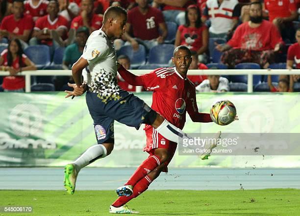 Alejandro Peñaranda of America de Cali and Raul Murillo of Atletico FC fight for the ball during a match between Atletico FC and America de Cali as...