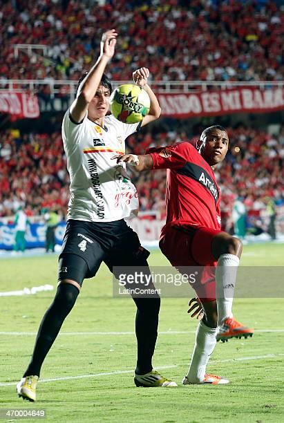 Alejandro Peñaranda of America de Cali struggles for the ball with Omel Escalante of Bogota during a match between America de Cali and Bogota as part...
