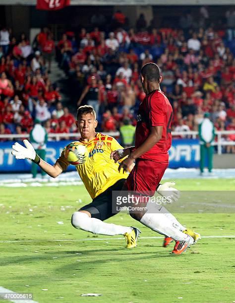Alejandro Peñaranda of America de Cali struggles for the ball with Yaser Chavez of Bogota during a match between America de Cali and Bogota as part...