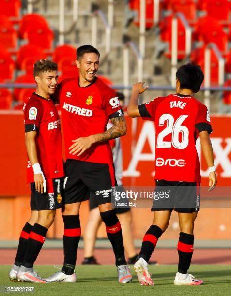 Alejandro Pozo of RCD Mallorca celebrates with his team mates Antonio Raillo and Takefusa 'Take' after scoring his team's third goalduring the Liga...