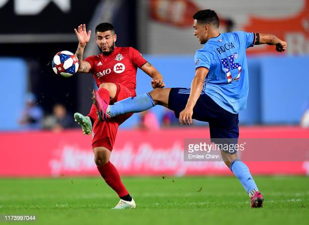 Alejandro Pozuelo of Toronto FC fights for the ball against Tony Rocha of New York City FC during the first half of their game at Yankee Stadium on...