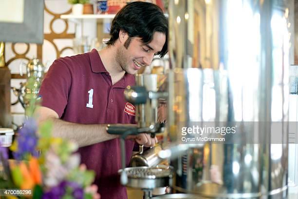 Alejandro Reinares creates a cortadito coffee drink with the Italian made Victoria Arduino Century espresso machine at Maria Empanada on 1298 S...
