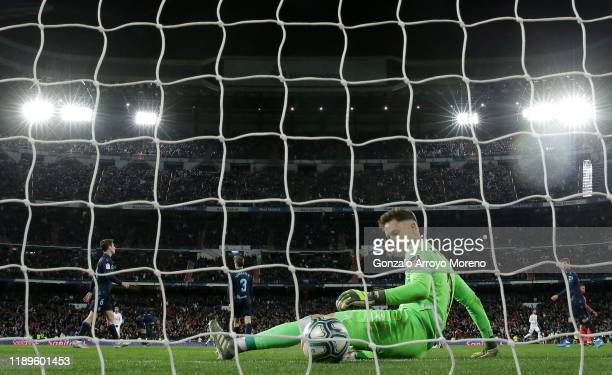 Alejandro Remiro of Real Sociedad looks dejected after Luka Modric of Real Madrid scores his sides third goal during the La Liga match between Real...