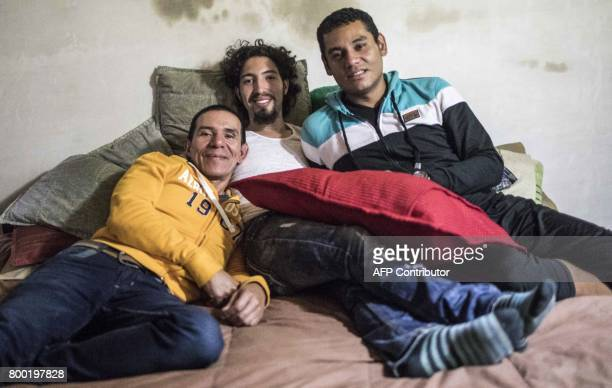 Alejandro Rodriguez Victor Prada and Manuel Bermudez pose for a photo at their home in Medellin Colombia on June 17 2017 The three men have gained...