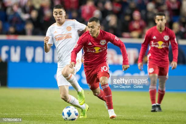 Alejandro Romero Gamarra of New York Red Bulls challenged by Miguel Almiron of Atlanta United during the New York Red Bulls Vs Atlanta United FC MLS...