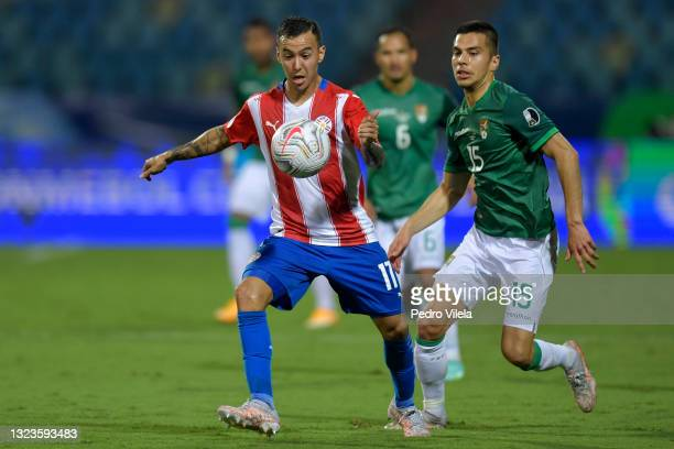 Alejandro Romero Gamarra of Paraguay competes for the ball with Boris Cespedes of Bolivia during a Group A match between Paraguay and Bolivia at...