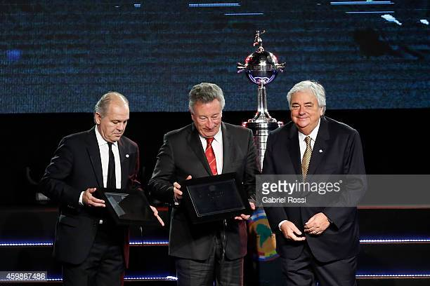 Alejandro Sabella former coach of Argentina and Luis Segura President of Argentina's Football Association receive a plaque during the Official Draw...