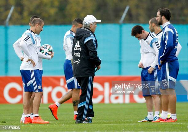 Alejandro Sabella head coach of Argentina gives instructions to his players during an Argentina training session at Ezeiza Training Camp on May 31...
