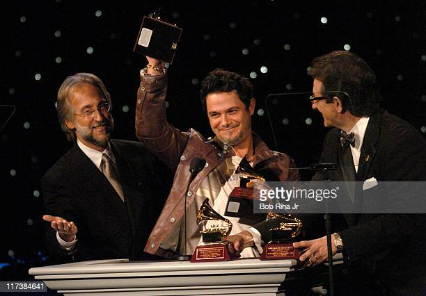Alejandro Sanz from Spain accepts his 2004 Grammy Awards in Beverly Hills Calif on Saturday Oct 2 2004 at the inaugural Noche de Nios Gala a...