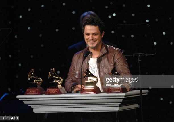 Alejandro Sanz from Spain accepts his four 2004 Latin Grammy Awards in Beverly Hills Calif on Saturday Oct 2 2004 at the inaugural Noche de Nios Gala