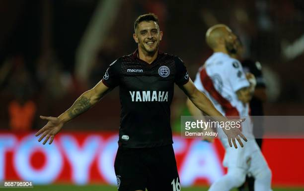 Alejandro Silva celebrates after scoring the fourth goal of his team during a second leg match between Lanus and River Plate as part of the...