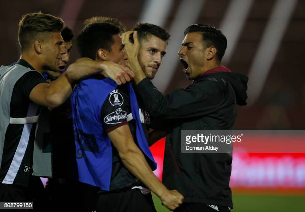 Alejandro Silva celebrates with teammates after scoring the fourth goal of his team during a second leg match between Lanus and River Plate as part...