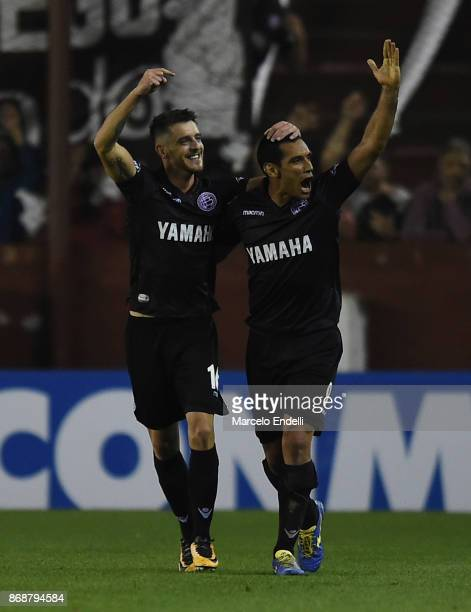 Alejandro Silva of Lanus celebrates with teammate Jose Sand after scoring the fourth goal of his team during a second leg match between Lanus and...