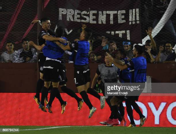 Alejandro Silva of Lanus celebrates with teammates after scoring the fourth goal of his team during a second leg match between Lanus and River Plate...