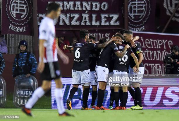 Alejandro Silva of Lanus celebrates with teammates after scoring the first goal of his team during a match between Lanus and River Plate as part of...