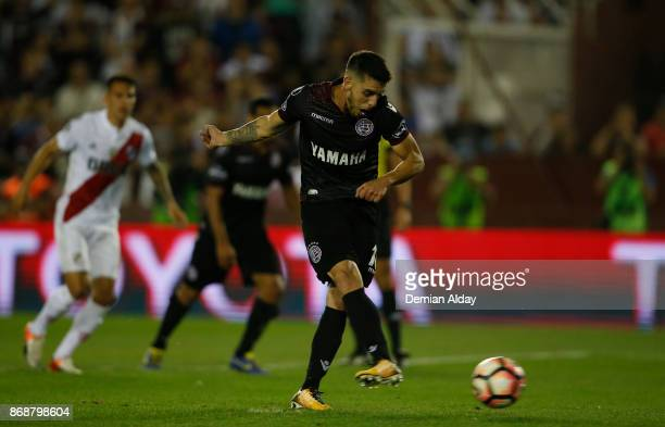 Alejandro Silva of Lanus kicks the penalty to score the fourth goal of his team during a second leg match between Lanus and River Plate as part of...