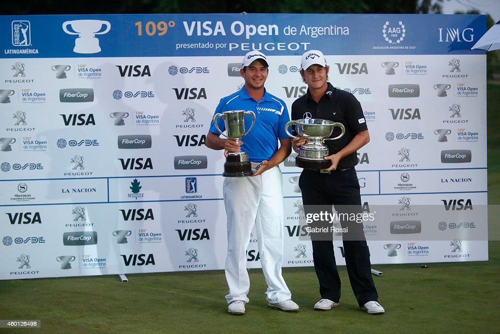 Alejandro Tosti (L) and Emiliano Grillo of Argentina (R) pose for a photo with their trophies at the end of the closing day of the 109th VISA Open Argentina as part of PGA Latinoamerica tour at Martindale Country Club on December 07, 2014 in Buenos Aires, Argentina.