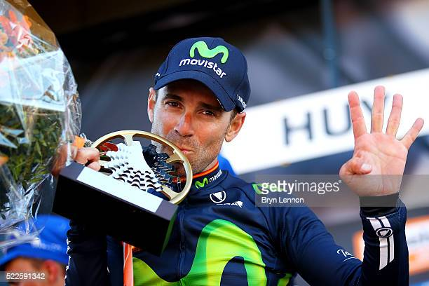 Alejandro Valverde of Spain and Movistar celebrates with the trophy on the podium after winning the 80th La Fleche Wallonne, a 196 km race from...