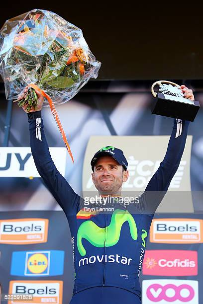 Alejandro Valverde of Spain and Movistar celebrates with the trophy on the podium after winning the 80th La Fleche Wallonne a 196 km race from...