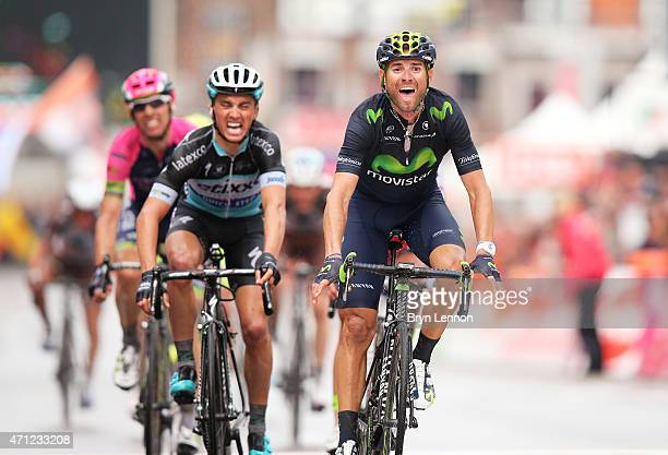 Alejandro Valverde of Spain and Movistar Team celebrates his victory as he crosses the finish line ahead of Julian Alaphilippe of France and Etixx -...