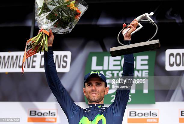 Alejandro Valverde of Spain and Movistar Team celebrates with the trophy following his victory during the 101st Liege-Bastogne-Liege cycle road race...