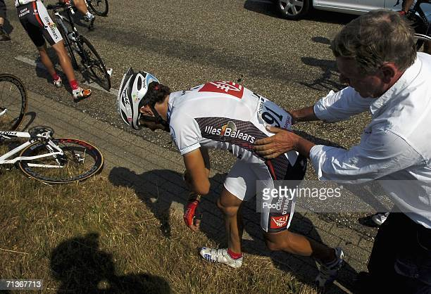 Alejandro Valverde of Spain and riding for Caisse D'Epargne receives medical attention as he lies on the side of the road injured after riders in the...