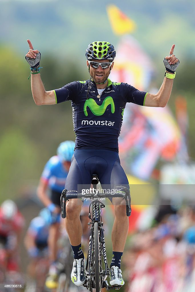 Alejandro Valverde of Spain and Team Movistar celebrates crossing the finish line to win the 78th edition of the La Fleche Wallonne on April 23, 2014 in Huy, Belgium. The 199km parcours scales the Mur de Huy climb three times, with the final 9.3% average ascent providing the finish to the race.
