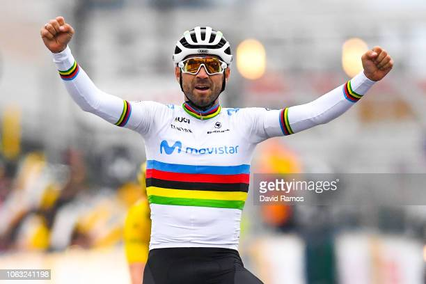 Alejandro Valverde of Spain and Team Movistar crosses the finish line ahead of Geraint Thomas of Great Britain and Team Sky wearing the yellow jersey...