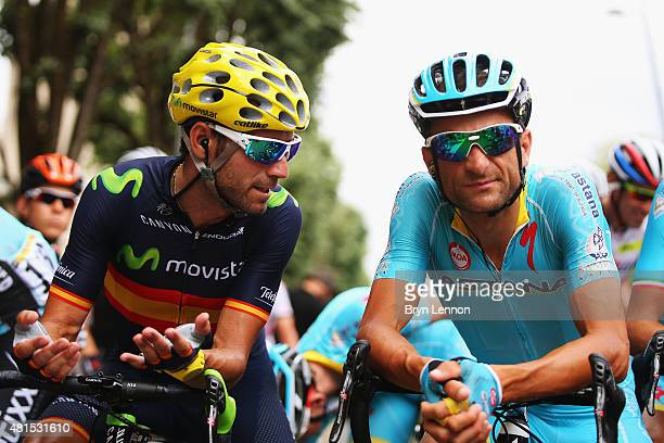 Alejandro Valverde of Spain and the Movistar team chats to Michele Scarponi at the start stage 14 during the 2015 Tour de France a 178km stage from...