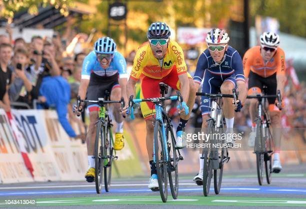 Alejandro Valverde of Spain crosses the finish line to win the Men's Elite road race of the 2018 UCI Road World Championships ahead of Romain Bardet...