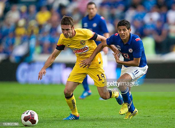 Alejandro Vela of Cruz Azul and Miguel Layun of America fight for the ball during a match between Cruz Azul end America as part of the Apertura 2012...