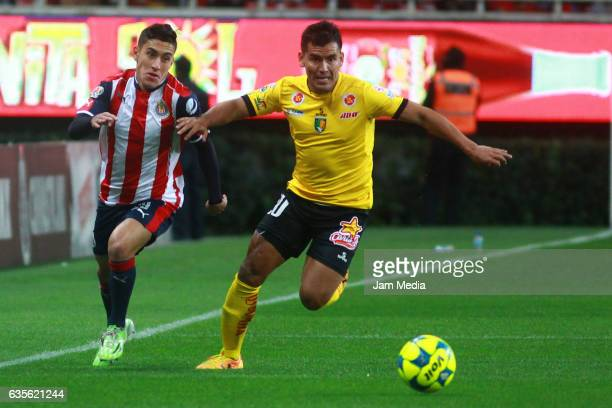 Alejandro Zendejas of Chivas and Manuel Lopez of Venados fight for the ball during the 4th round match between Chivas and Venados as part of the...