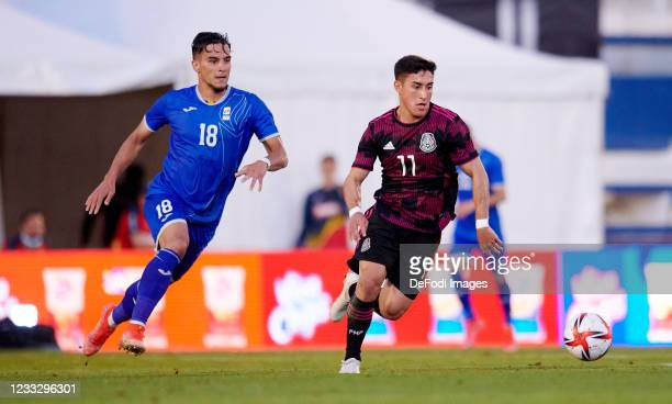Alejandro Zendejas of Mexico U23 and Boboc of Romania U23 battle for the ball during the international friendly match between Mexico U23 and Romania...