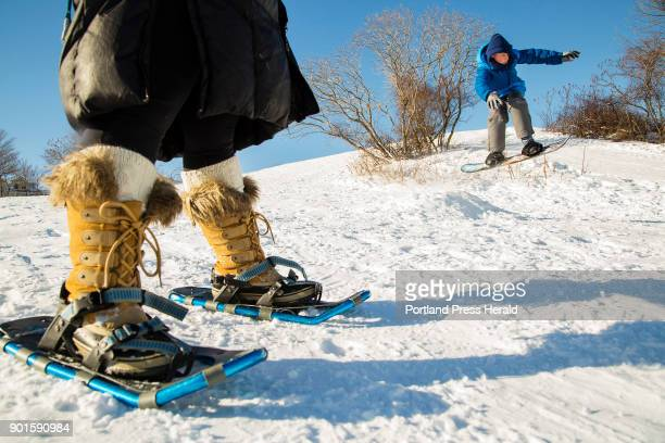 Alek Greenwald 12 of Westwood Mass takes to the air while snowboarding at the Eastern Promenade in Portland Wednesday morning Aleks mother Suzanne...
