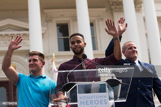 Alek Skarlatos Anthony Sadler and Spencer Stone wave to the crowd during a parade honoring their August 21 actions in overpowering a gunman on a...