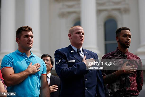 Alek Skarlatos Spencer Stone and Anthony Sadler recite the Pledge of Allegiance on stage during a parade honoring their August 21 actions in...
