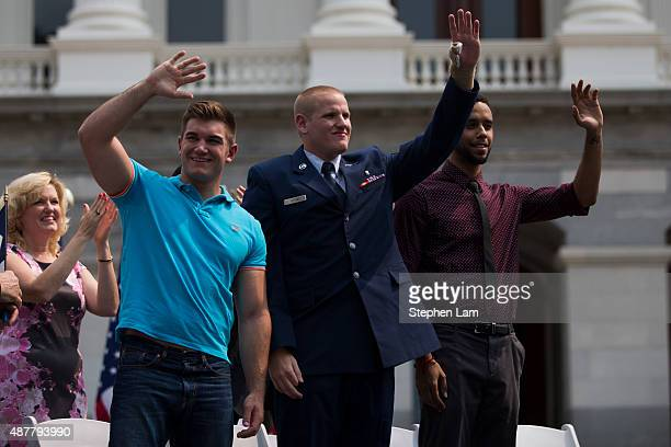 Alek Skarlatos Spencer Stone and Anthony Sadler wave to the crowd during a parade honoring their August 21 actions in overpowering a gunman on a...