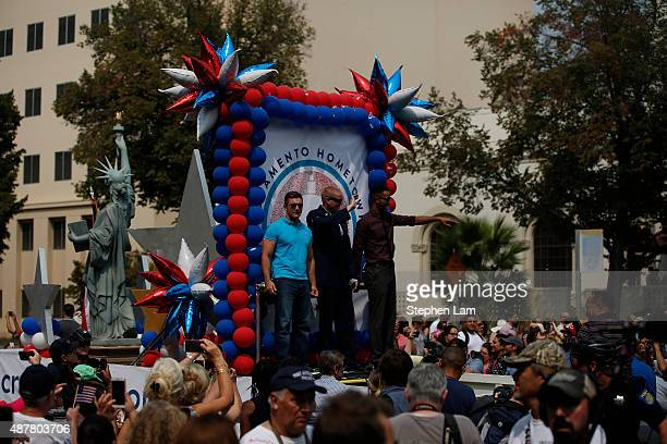 Alek Skarlatos Spencer Stone and Anthony Sadler wave to the crowd along Capitol Mall during a parade to honor their August 21 actions in overpowering...