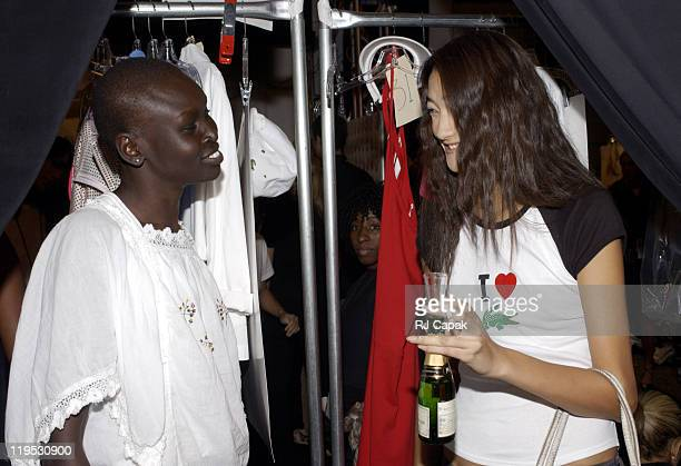 Alek Wek and Ai Tominaga during MercedesBenz Fashion Week Spring 2004 Lacoste Backstage at Gertrude Tent Bryant Park in New York City New York United...