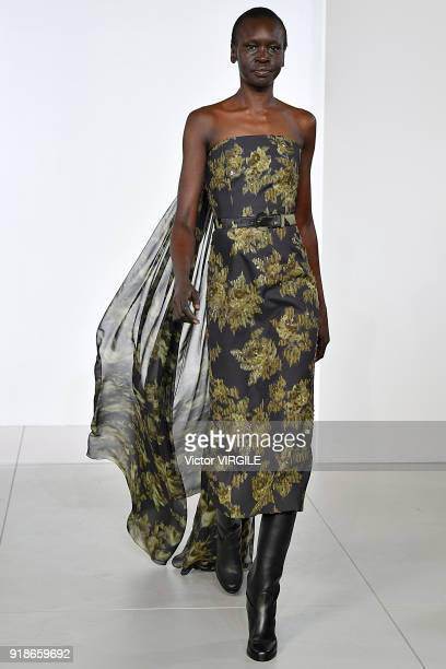 Alek Wek walks the runway at the Michael Kors Ready to Wear Fall/Winter 20182019 fashion show during New York Fashion Week on February 14 2018 in New...
