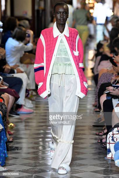 Alek Wek walks the runway during the finale of the Miu Miu 2019 Cruise Collection Show at Hotel Regina on June 30 2018 in Paris France