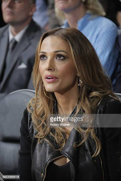Aleka Kamila watches as her husband Peja Stojakovic has his jersey retired during haltime against the Oklahoma City Thunder at Sleep Train Arena on...