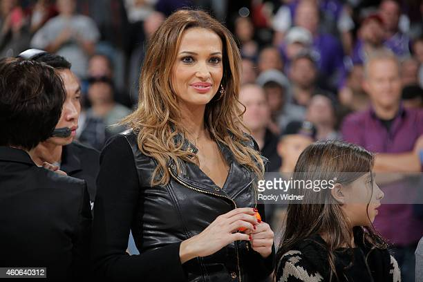 Aleka Kamila watches as her husband Peja Stojakovic has his jersey retired during haltime against the Oklahoma City Thunder on December 16 2014 at...